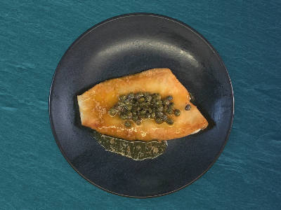 Sole in Caper Butter on a plate, ready to serve.